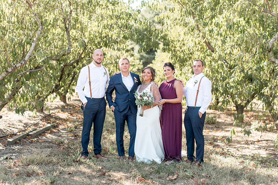 Wedding party portraits in the orchard at Bast Brothers