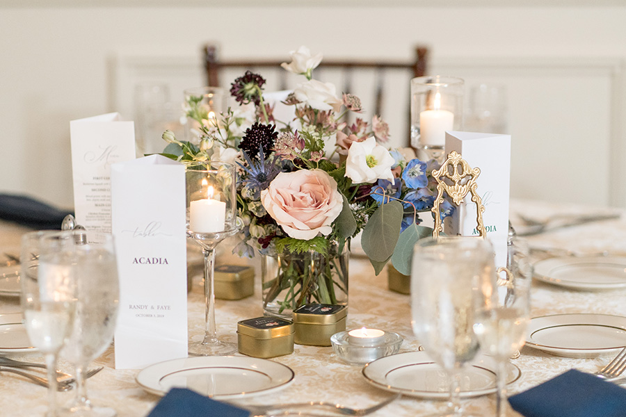 Blush and burgundy wedding flower centerpieces at David's Country Inn