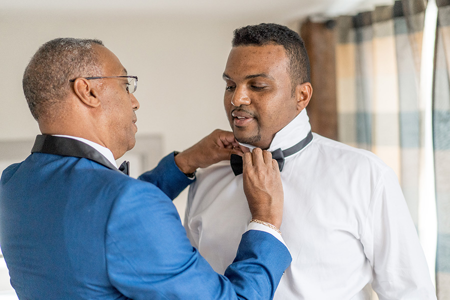 Groom's father getting ready before wedding