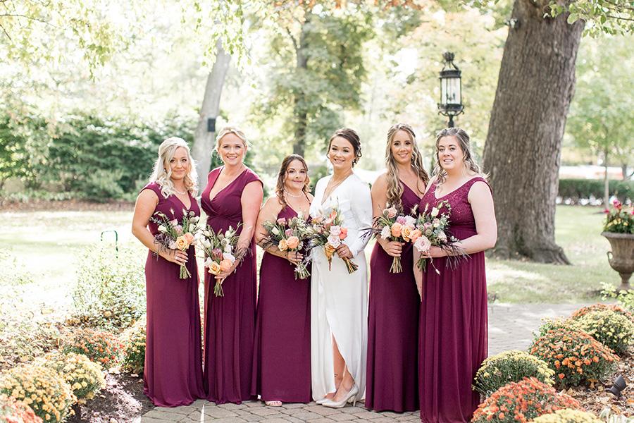 bridesmaids in autumn colored floor length dresses