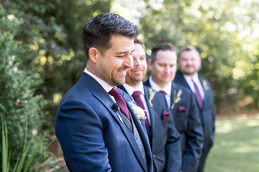 Groom sees his bride walking down the aisle