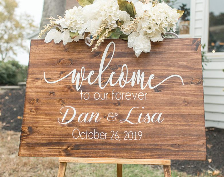 rustic wooden welcome to our wedding sign