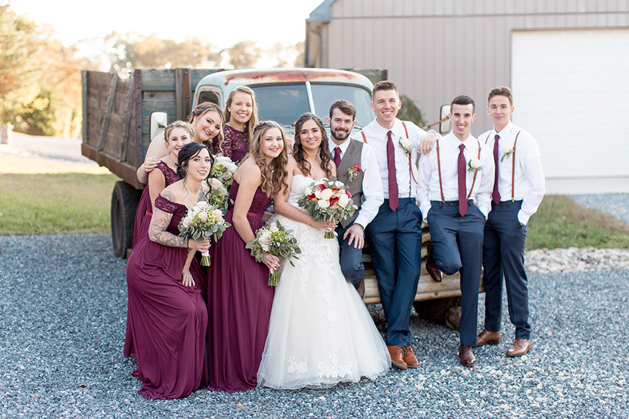 wedding party by rustic truck