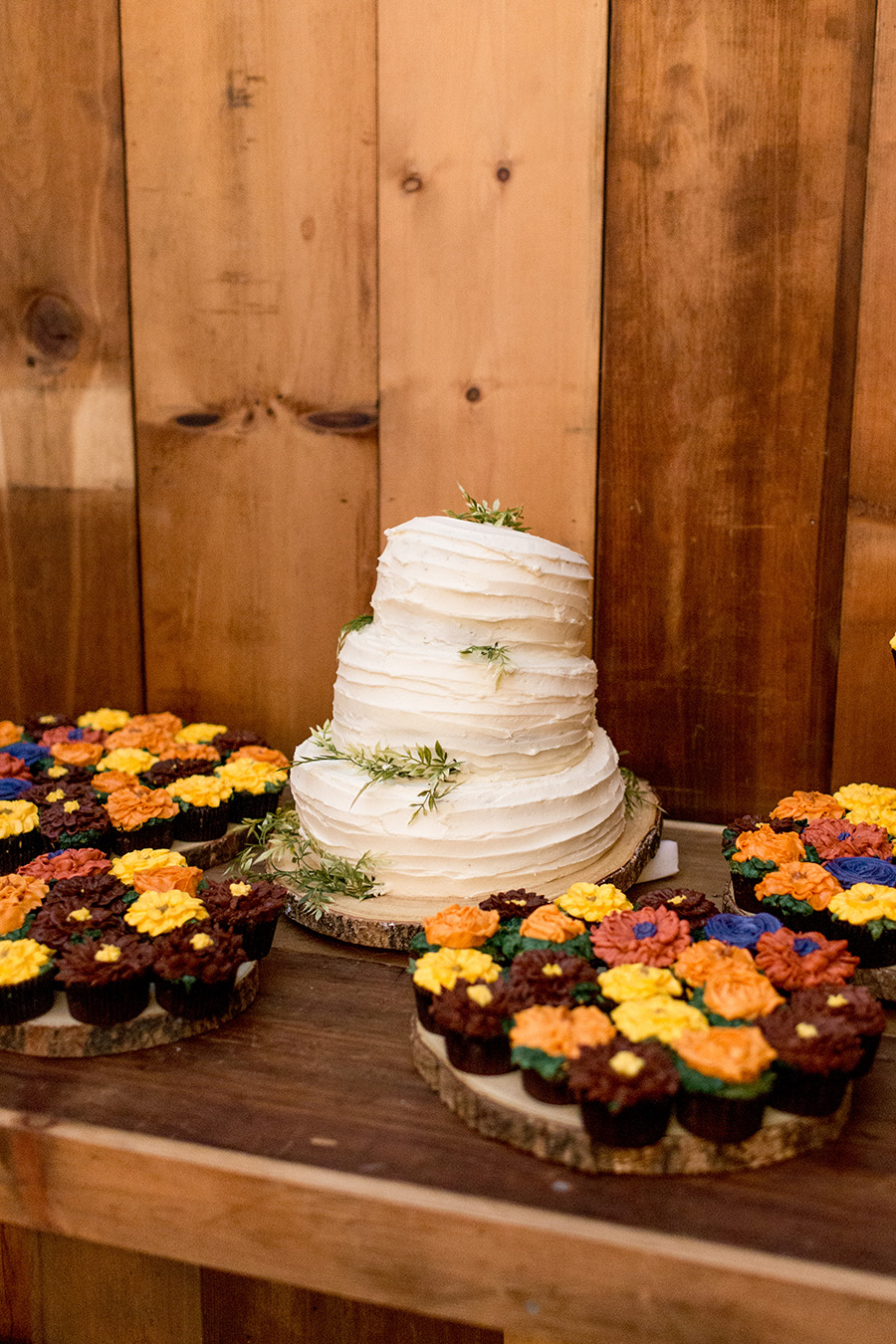 homemade wedding cake and sunflower cupcakes