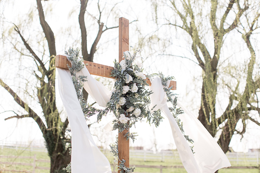 country ceremony cross at the wedding altar