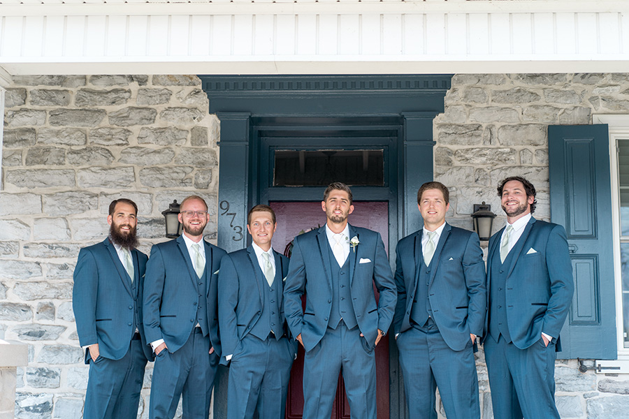groom and his groomsmen in navy tuxes