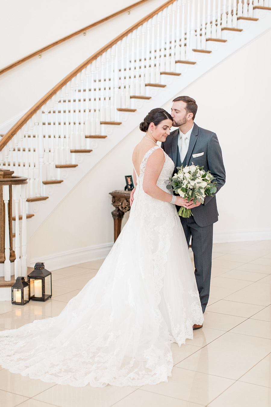 bride and groom by the staircase
