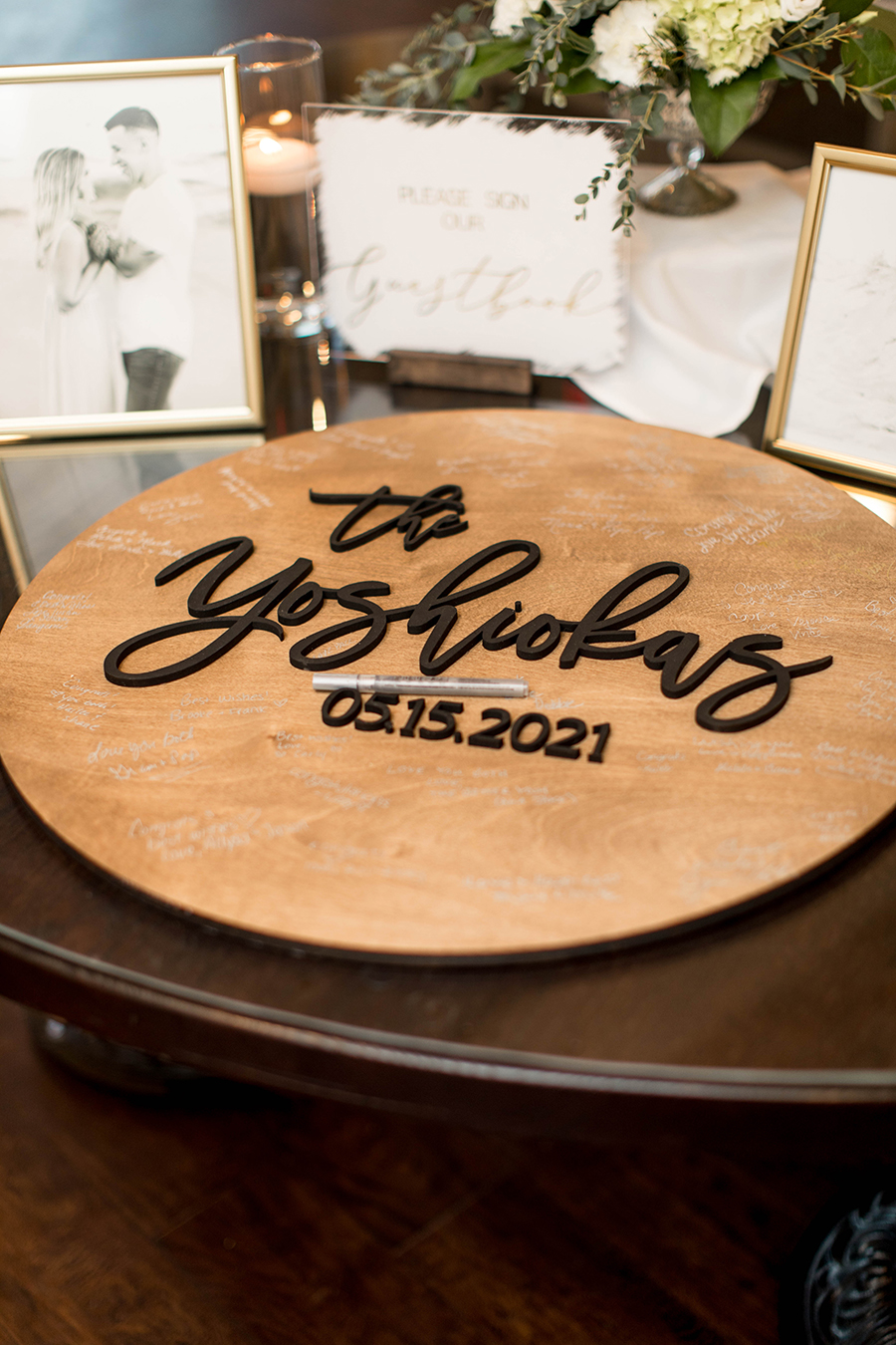 wooden guestbook sign with the couple's name and wedding date