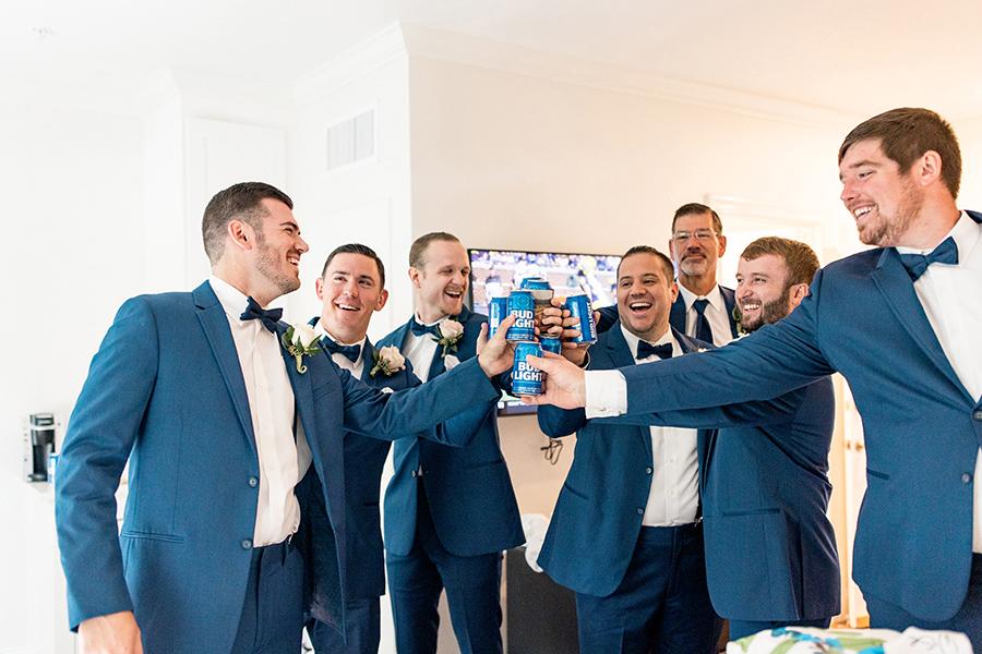 groomsmen cheers the groom before the wedding