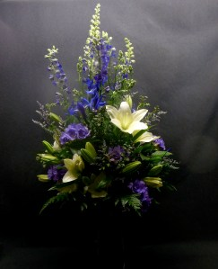 picture of arrangement with Delphinium and Lilies