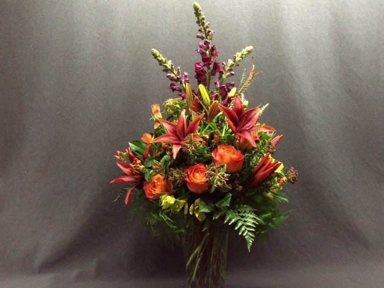 picture of bouquet with roses, lilies and snapdragon