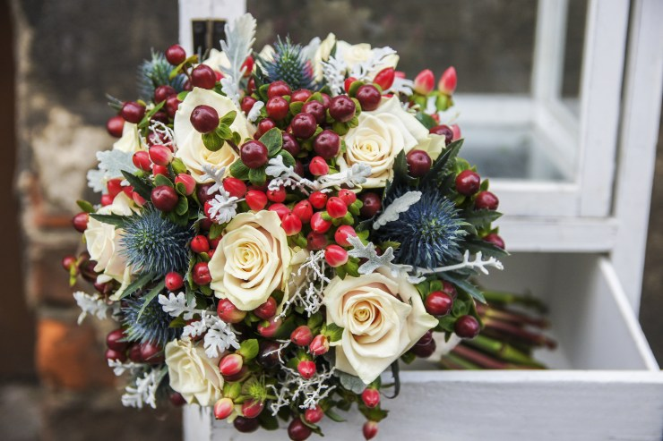 Wedding bouquet with roses and hypericum