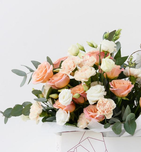 Petals Signature Floral Design Paired with White and Greens