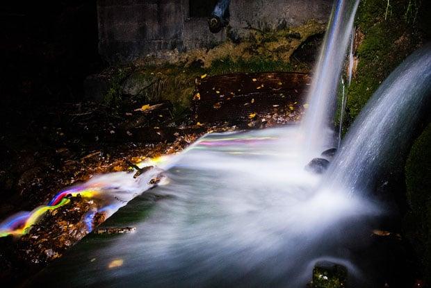 Colorful Long Exposure Photos of Glow Sticks Dropped Into Waterfalls glowwaterfall 2