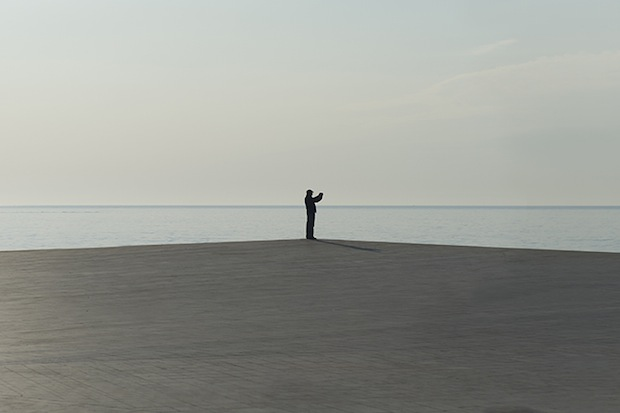 Minimalist Photos of Overcast Sunrises Over the Barcelona Sea grey10
