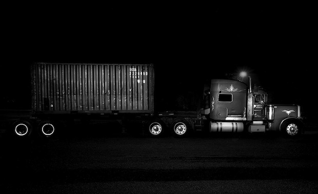 Black and White Night Photos of Dormant 18 Wheelers at Truck Stops blackdog5