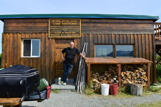 """A picture of me at the """"Cook Shack,"""" the only enclosed structure (other than the outhouses) that the campers can go into.  For safety, all food is stored in there and that is where all meals are cooked and eaten."""