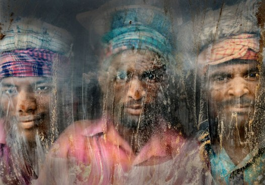 [This] gravel-crush working place remains full of dust and sand. Three gravel workmen are looking through the window glass at their working place. Chittagong, Bangladesh. Photo and caption by Faisal Azim/National Geographic Traveler Photo Contest