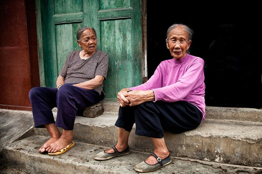 Older Chinese women sitting on the stairs