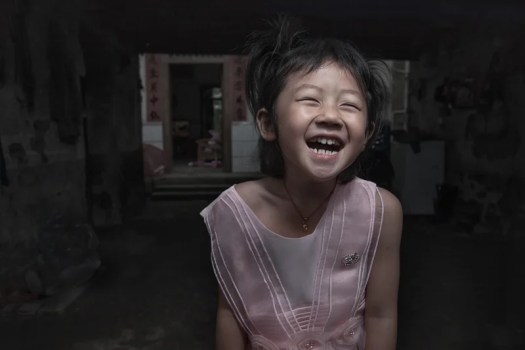 A young Chinese girl enjoying getting her picture taken.