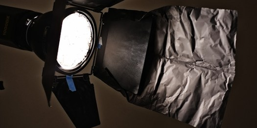 I've used Cinefoil here to mould onto my barn door to create an extra large flag to control the spill of light.