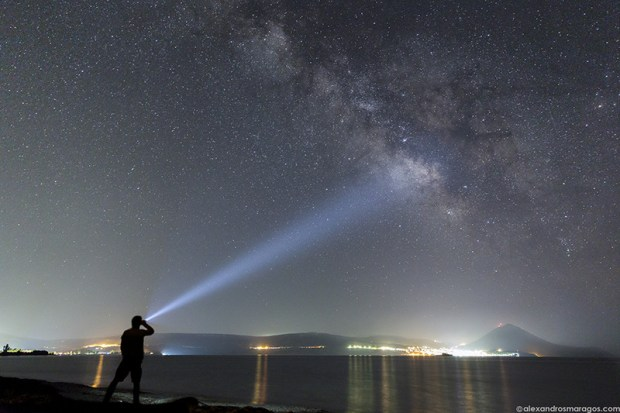 (Selfie) Pointing at the Galactic center of the Milky Way over the town of Pylos in Messinia, Greece