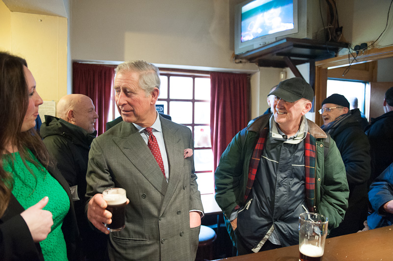 Prince Charles enjoys a beer in Toxteth, Liverpool.