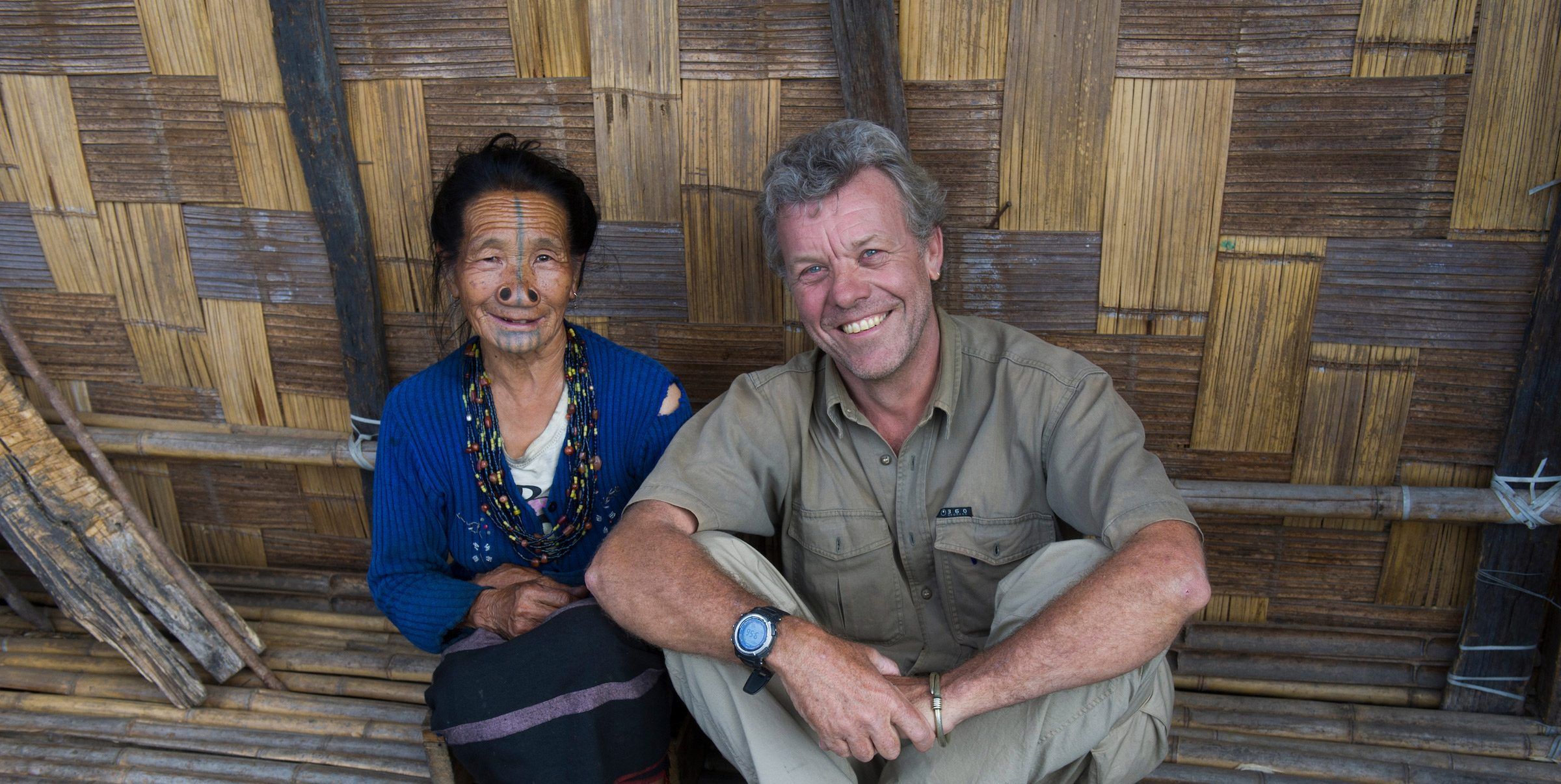 Conservation Photographer Pete Oxford sits with an indigenous Apatani woman.