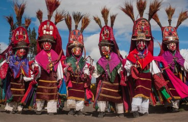 A group of men are shown in traditional Corpus Christi dress. Photo by travel photographer and conservation photographer Pete Oxford.