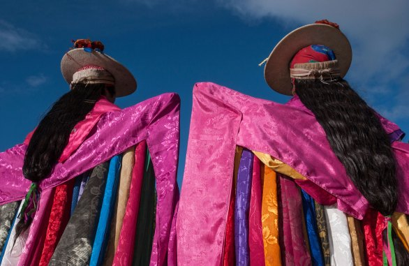 Two men are shown in traditional Corpus Christi dress. Photo by indigenous person photographer and conservation photographer Pete Oxford.