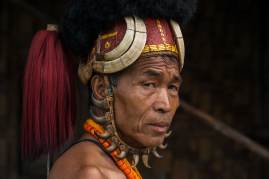 An indigenous man from the Chang Naga headhunting Tribe displays his headdress and traditional attire. Photograph by conservation photographer and cultural photographer Pete Oxford.