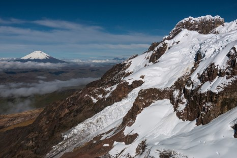 Antisana volcano in Ecuador rises above the clouds in the distance. Photo by conservation photographer and landscape photographer Pete Oxford.
