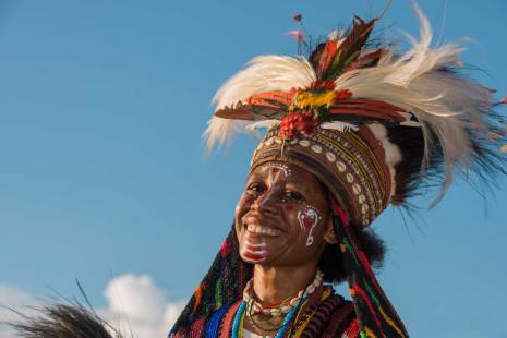 The traditional dress including a bird of paradise headdress is shown off by a native woman. Photo by conservation photographer and cultural photographer Pete Oxford.