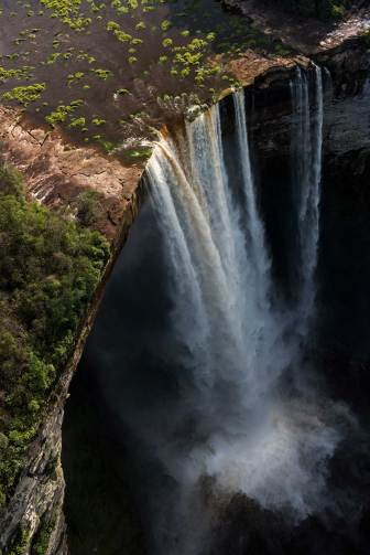 Kaieteur Falls flows strongly over the precipice. Photograph by aerial photographer and conservation photographer Pete Oxford.