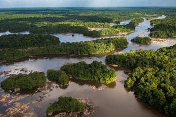 The Essequibo River winds its way through Guyana leaving small islands of forest. Photo by conservation photographer and landscape photographer Pete Oxford.