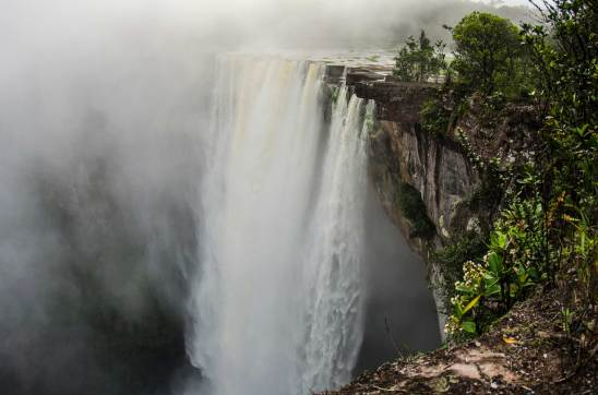 Kaieteur Falls flows with clouds of mist rising into the air. Photo by conservation photographer and landscape photographer Pete Oxford.