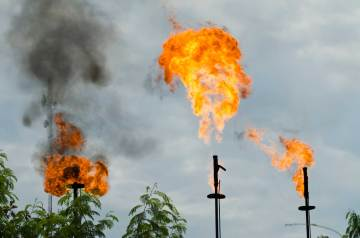 Flaming gas burn off stations are shown in the Sacha Oil Block in the Amazon Rainforest. Photo by conservation photographer Pete Oxford.