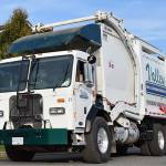 photo of a new Peterbilt Model 320 equipped for handling refuse