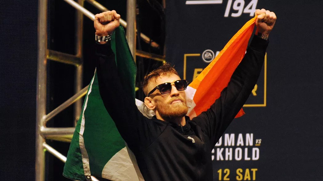 Conor McGregor holding his country's flag probably after movement training