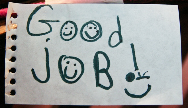 A hand drawn sign saying Good job and a smiley face
