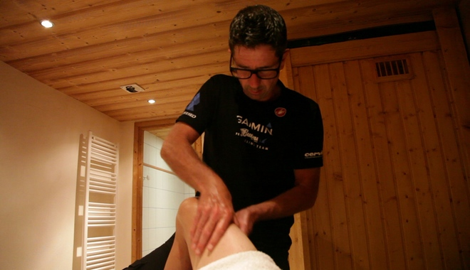 A masseuse massaging quads