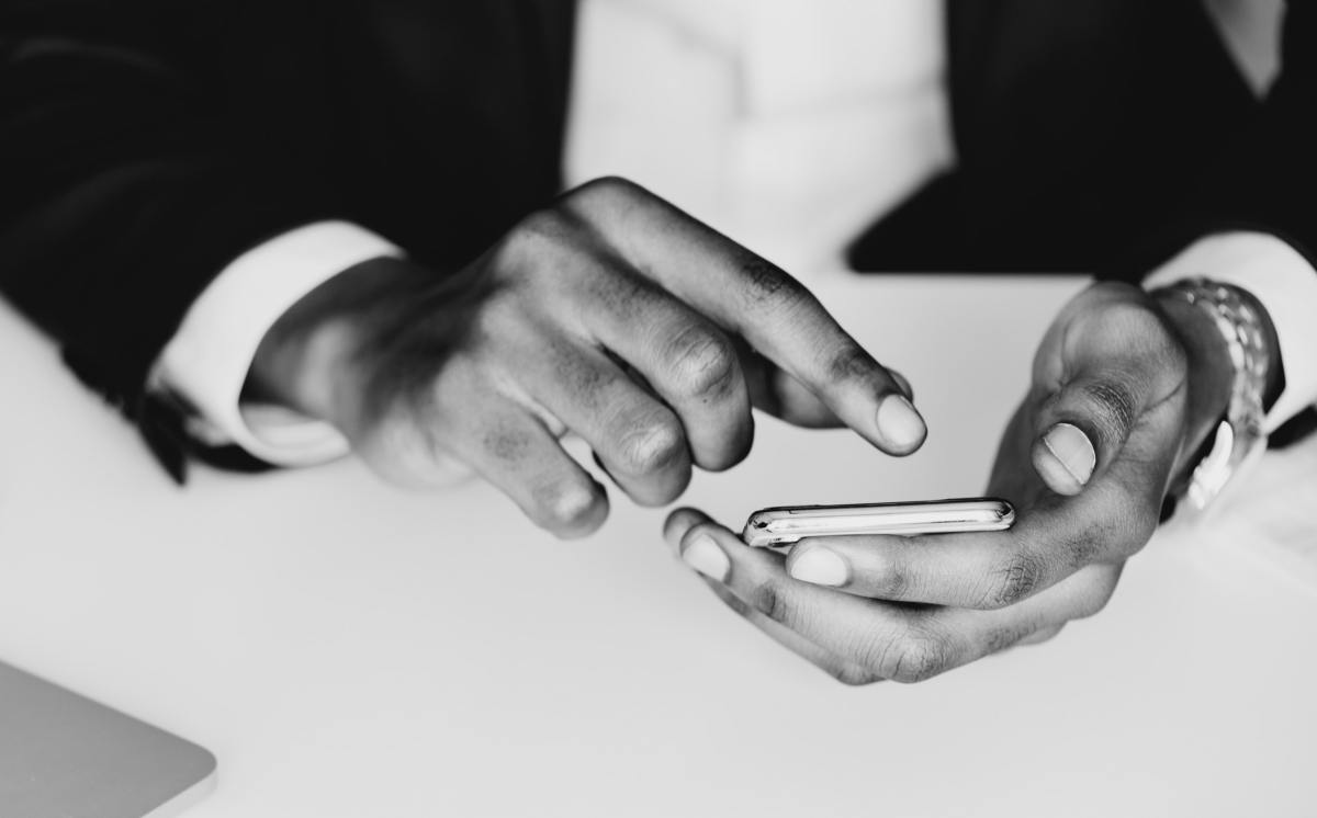 Pair of hands holding a smartphone