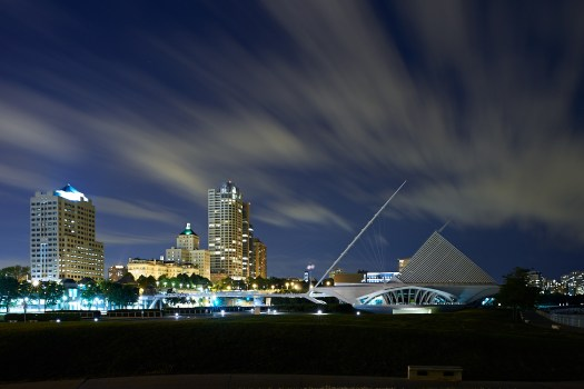 The Milwaukee Art Museum at night.