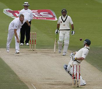 England's Andrew Flintoff testing Phillip Hughes' technique against fast, short-pitched bowling
