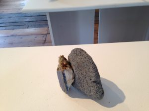 Pumice paperweight with wooden handle for small sheets of paper