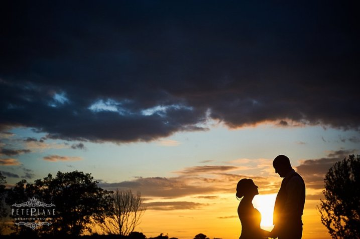 bride and groom on sunset by Peter Lane London wedding photographer
