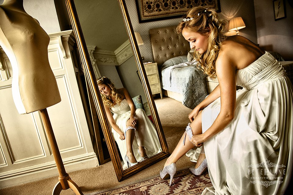 london wedding photographer - bride getting ready in front of mirror