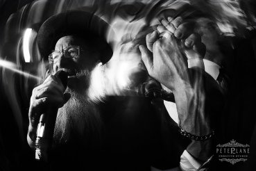 jewish wedding photographer London rabbi singing