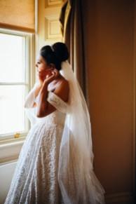 bride fixing earings