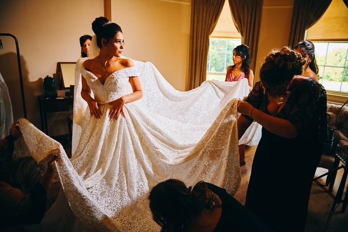 bridesmaids helping bride